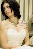 Sexy tattoo woman in bridal dress. Tattooed woman - sexy brunette bride in white wedding dress Royalty Free Stock Image