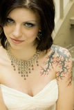 Sexy tattoo woman in bridal dress. Tattooed woman - sexy brunette bride in white wedding dress Stock Photos