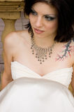 Sexy tattoo woman in bridal dress Royalty Free Stock Photography