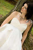 Sexy tattoo woman in bridal dress Royalty Free Stock Photos