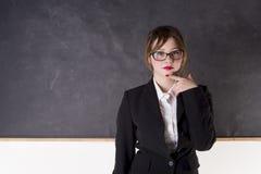Sexy teacher. With blackboard looking you Stock Photos