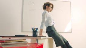 teacher in classroom or corporate office