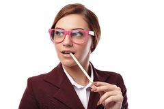 Sexy teacher holding a pen in the mouth and wearing nerd glasses Stock Images