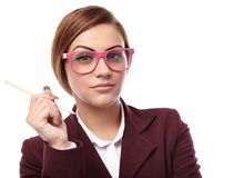 Sexy teacher holding a pen and wearing glasses Royalty Free Stock Image