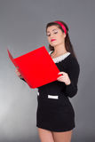Sexy teacher with red folder. Over grey Stock Photo