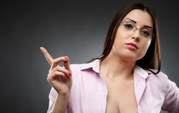 Sexy teacher wearing glasses and showing her finger Stock Images