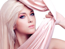 Sexy tender woman with pink silk. Royalty Free Stock Photos