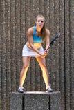 tennis player posing in an urban setting Stock Photo