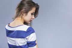 and Thin Caucasian Brunette Girl in Jeans and Striped Shirt Stock Photo