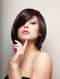 Sexy thinking alluring girl with short hair. Sexy thinking alluring girl with short black hair Stock Photography