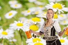 Sexy tiroler woman with a big glass of beer Royalty Free Stock Photos