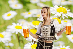Sexy tiroler woman with a big glass of beer Stock Photos