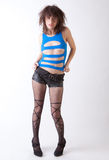 Sexy Top and Stockings. An image of an attractive model with messy hair, wearing a revealing top and patterned fishnet tights Stock Photography