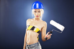 Sexy topless model holding a roller brush. Royalty Free Stock Photos