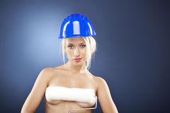 Sexy topless model holding a roller brush. Stock Image