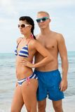 Sexy trendy couple posing in swimwear at the sea Stock Photography