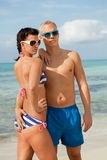 Sexy trendy couple posing in swimwear at the sea Royalty Free Stock Images
