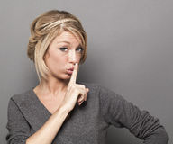 Sexy trendy woman asking to keep quiet for discretion Stock Image