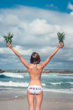 Sexy tropical woman butt close up with exotic pineapple fruit on the beach of paradise island of Bali. Healthy diet Royalty Free Stock Photo