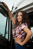 Sexy truck driver. Pretty truck driver in plaid shirt near cabin Stock Photography