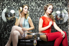 Sexy twins listening to music Stock Image