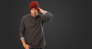 Sexy urban hipster standing in front of grey background.  Royalty Free Stock Images