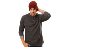 Sexy urban hipster standing in front of white background.  Royalty Free Stock Photo