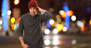 Sexy urban hipster standing next to street at night Royalty Free Stock Photos