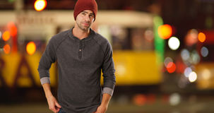 Sexy urban hipster standing next to street at night Royalty Free Stock Image