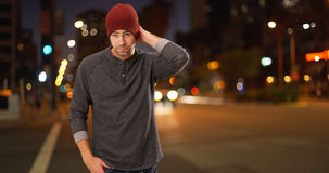 Sexy urban millennial standing next to street at night Stock Photography