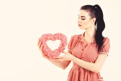 Valentine model Girl portrait. Gorgeous Valentines young brunette woman with heart shaped gift. Perfect make up stock photos