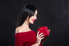 Sexy Valentine model Girl portrait. Gorgeous young brunette woman with red gift box. Perfect make up. Valentine` Day brunette lady Royalty Free Stock Images