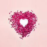 Sexy valentine red beads heart on pink Stock Image