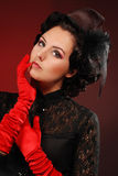 Sexy vamp woman. With creative hairstyle and red gloves Royalty Free Stock Photo