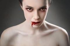 Vampire. Portrait of a female vampire over black background stock photography