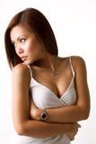 Sexy verleidelijke Aziatische vrouw die aan de kant kijkt royalty-vrije stock foto's