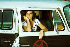 Vintage. Young Woman standing in alley next to old van royalty free stock photo