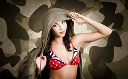 Sexy vintage army girl saluting Stock Image
