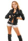 Sexy vrouw in de kleding van de rotsstijl royalty-vrije stock fotografie