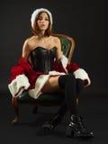 Sexy vrouw met Kerstmanlaag en korset Stock Afbeeldingen
