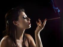 Sexy vrouw met mondstuk Stock Foto's