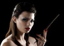vrouw met mondstuk Royalty-vrije Stock Foto's