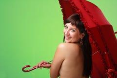 Sexy vrouw met rode paraplu stock afbeelding