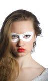 Sexy vrouw met witte partijmas Stock Foto's