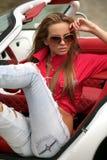 Sexy vrouw in sportwagen Royalty-vrije Stock Fotografie