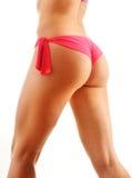 Sexy weibliche Hinterteile lokalisiert auf weißem Hintergrund Lizenzfreies Stockbild