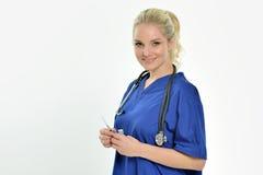 Sexy weiblicher medizinischer Fachmann mit Nadel Stockbild