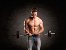 Sexy weight lifter guy showing muscles Stock Photos