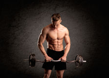 Sexy weight lifter guy showing muscles Stock Photography
