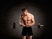 weight lifter guy showing muscles Royalty Free Stock Photos